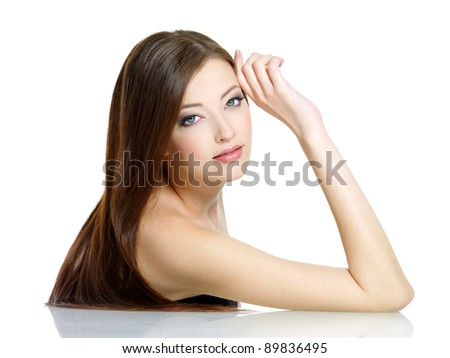 Portrait of young attractive woman with long straight beautiful hair - white background - stock photo