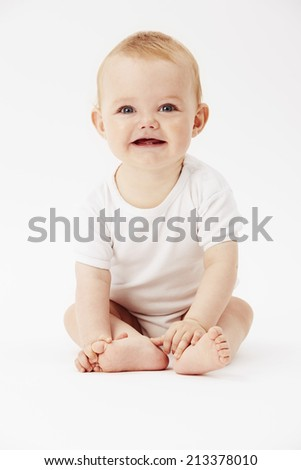 Portrait of young baby boy, smiling