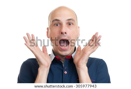 Portrait of young bald man with shocked facial expression, isolated over white background
