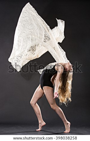 Portrait of young ballet dancer with flying lace