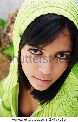 Portrait of young beautiful african american teen girl in green hood.