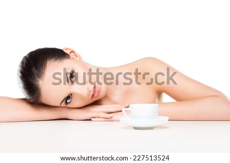 Portrait of young, beautiful and healthy woman drinking morning coffee isolated on white - stock photo