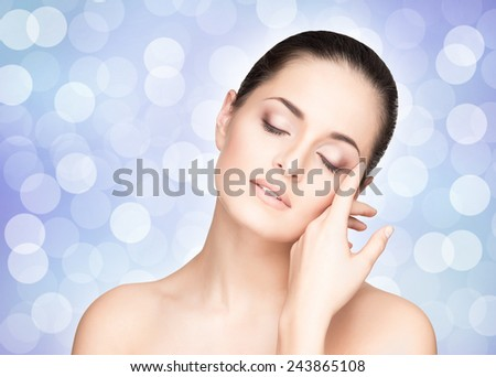 Portrait of young, beautiful and healthy woman. Perfect complexion. - stock photo