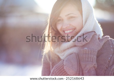 Portrait of young, beautiful and pretty woman in cold sunny winter weather - Outdoor portrait
