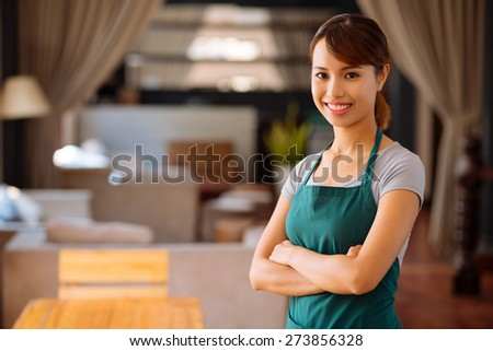 Portrait of young beautiful Asian cafe owner - stock photo