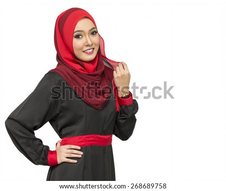 Portrait of young beautiful Asian muslim woman wearing hijab. - stock photo