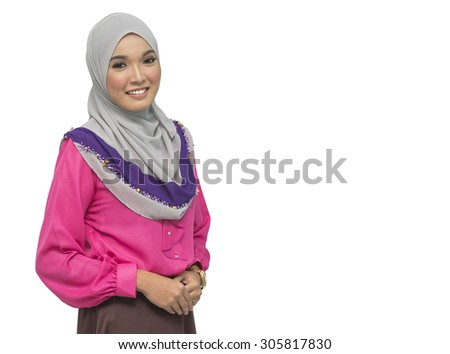 Portrait of young beautiful Asian muslim woman wearing hijab.