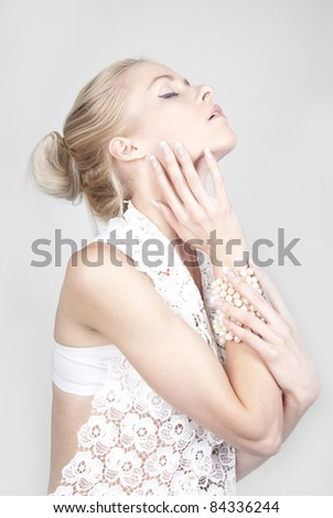 Portrait of young beautiful blond woman with long acrylic nails - stock photo