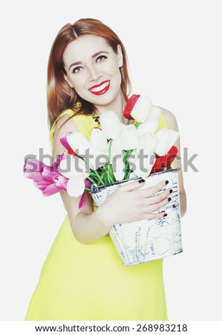 Portrait of young beautiful blonde woman with flowers - stock photo