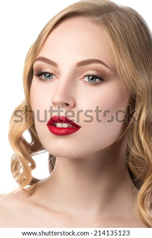 Portrait of young beautiful blonde woman with red lips