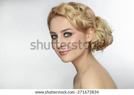 Portrait of young beautiful blonde woman with stylish prom hairdo - stock photo