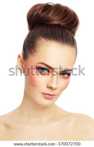 Portrait of young beautiful blue-eyed woman with stylish sunny make-up over white background