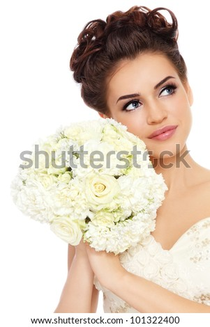 Portrait of young beautiful bride with stylish make-up and hairdo looking upwards, over white background - stock photo