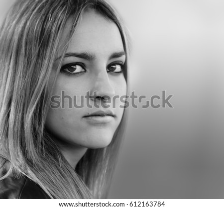 Portrait of young beautiful brunette.Black and white