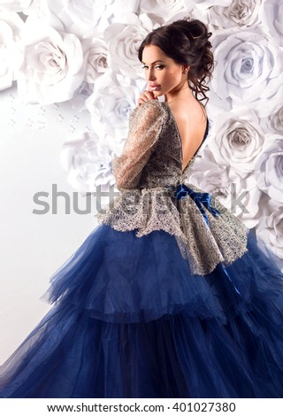 Portrait of young beautiful brunette princess woman in fairy luxury blue dress