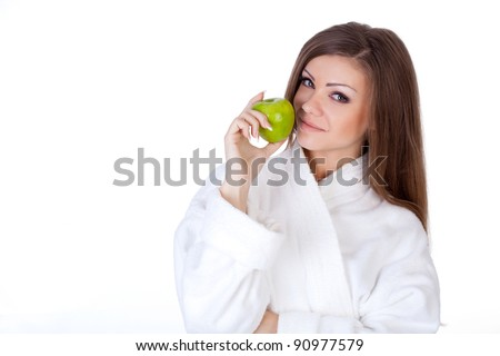 Portrait of young beautiful brunette woman holding apple isolated