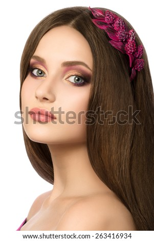 Portrait of young beautiful brunette woman with purple hair-slide in her hair - stock photo