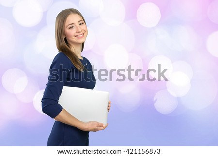 Portrait of young beautiful brunnete woman holding laptop