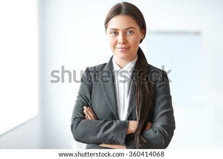 Portrait of young beautiful business woman in the office