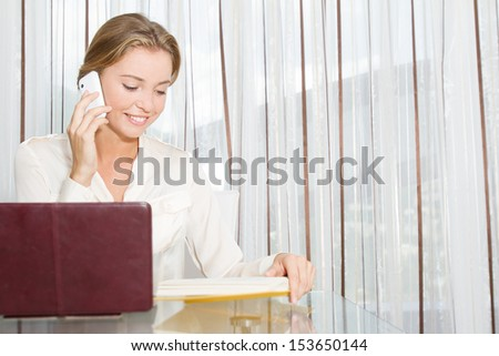 portrait of young beautiful business woman working with laptop in office - stock photo