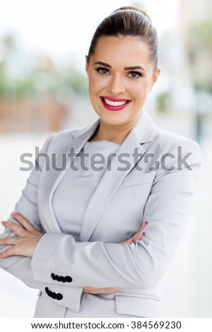 portrait of young beautiful businesswoman in office - stock photo