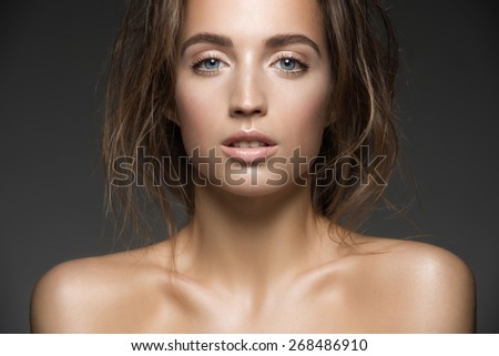Portrait of young beautiful caucasian woman. Beauty care concept of beautiful caucasian female model  with healthy skin. - stock photo