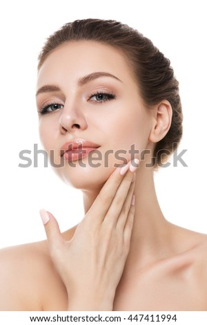 Portrait of young beautiful caucasian woman touching her face isolated over white background. Cleaning face, perfect healthy skin. SPA therapy, skincare, cosmetology and plastic surgery concept - stock photo