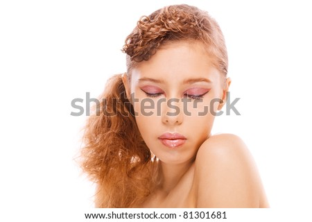Portrait of young beautiful dreamy woman with eyes closed against white background. - stock photo
