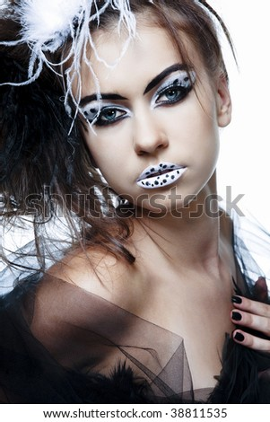 Portrait of young beautiful fashion model with full make-up.