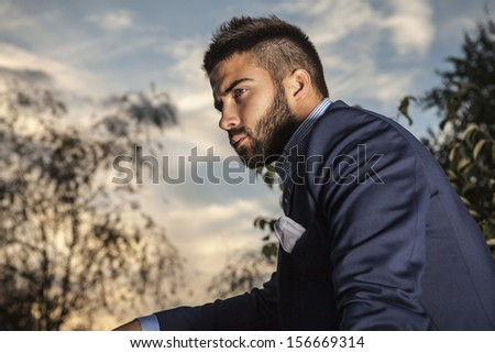 Portrait of young beautiful fashionable man outdoor.