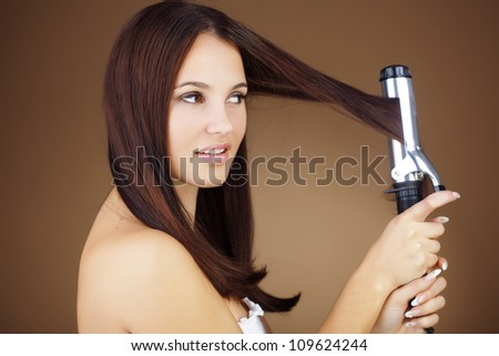 Portrait of young beautiful girl doing hairstyle - stock photo
