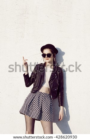 Portrait of young beautiful girl in stylish clothes. Rock woman. Fashion. Glamour. Hipster model. - stock photo