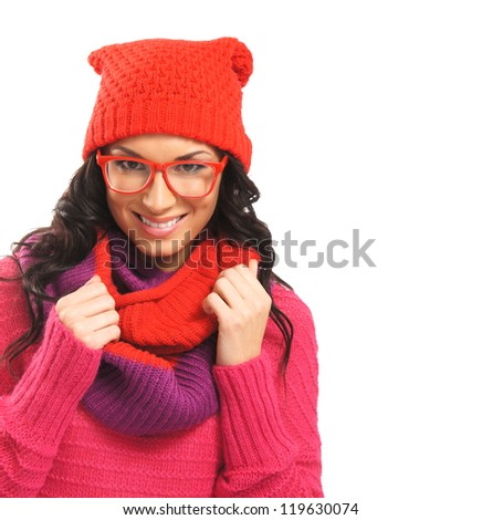 Portrait of young beautiful girl in winter style isolated on white