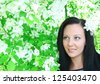 Portrait of young beautiful girl near blooming apple tree Space for inscription - stock photo