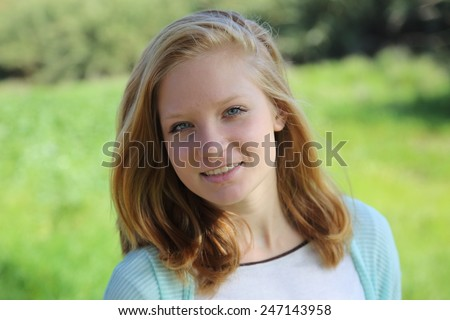 Portrait of young beautiful girl  on a background of nature - stock photo