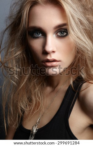 Portrait of young beautiful girl with blonde hair. Fashion photo Hairstyle. Make up. Vogue Style. - stock photo