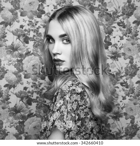 Portrait of young beautiful girl with blonde hair. Fashion photo Hairstyle. Make up. Vogue Style. Black and white photo - stock photo