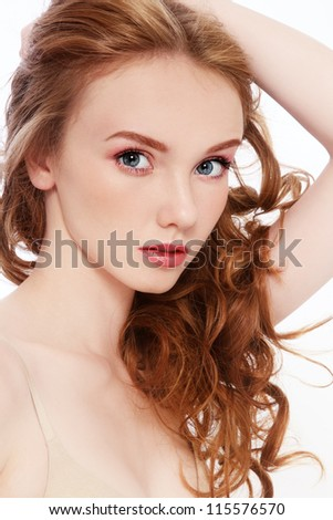 Portrait of young beautiful girl with curly red hair - stock photo