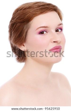 Portrait of young beautiful girl with fresh pink make-up over white background