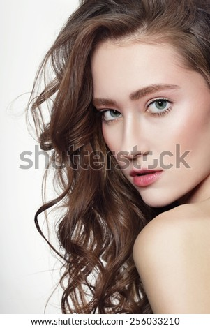 Portrait of young beautiful girl with long healthy curly hair - stock photo