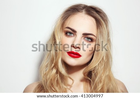 Portrait of young beautiful girl with long messy hair and red lips