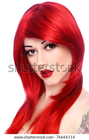 Portrait of young beautiful girl with long red hair and fancy make-up - stock photo