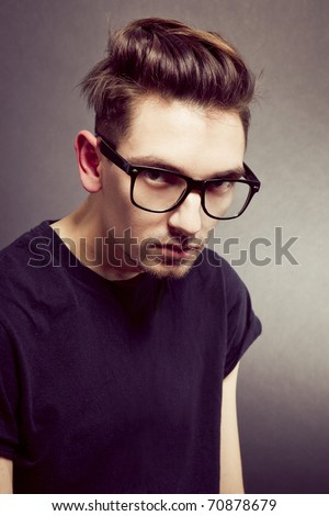 Portrait of young beautiful man in glasses
