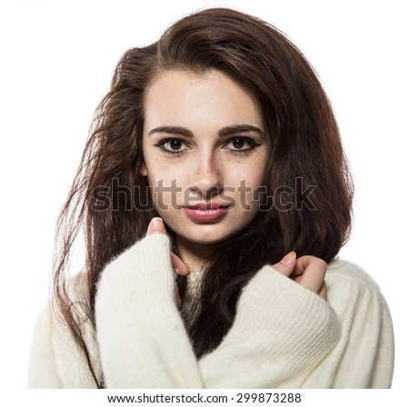 Portrait of young beautiful model with freckles with healthy skin and long brunette hair. With crossed hands on her chest. Isolated on a white background. - stock photo