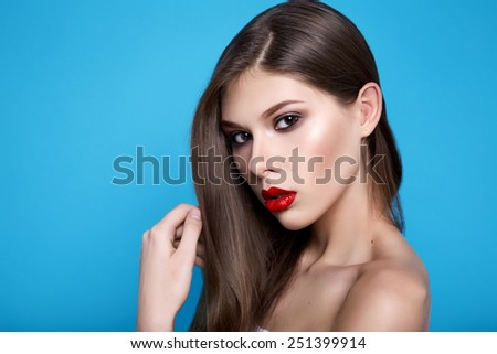 Portrait of young beautiful perfect sexy woman with long smooth hair well-groomed, fashionable styling hair, evening make-up organic cosmetics, facial features in a beauty salon - stock photo