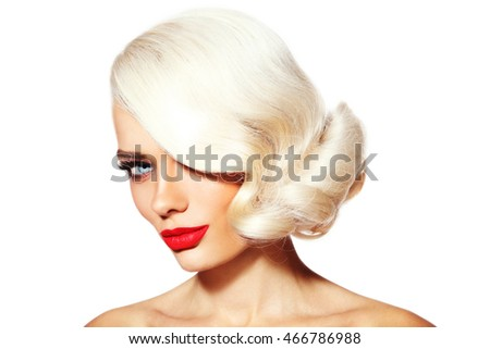 Portrait of young beautiful platinum blonde tanned woman with vintage hairdo and red lipstick over white background