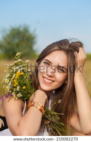Portrait of young beautiful pretty cute romantic happy ukrainian woman wearing a wreath of wild flowers in summer day, outdoors. Series of photos