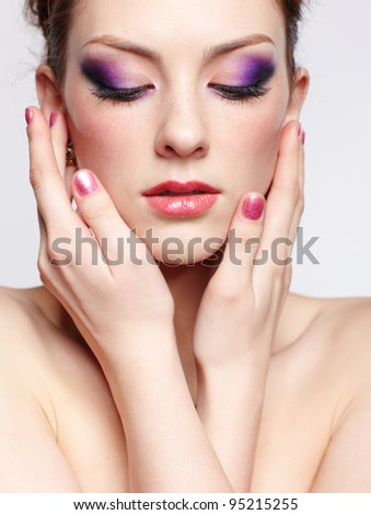 portrait of young beautiful red-haired woman touching face with manicured fingers and closing eyes - stock photo