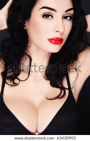 Portrait of young beautiful sexy brunette in black bra - stock photo