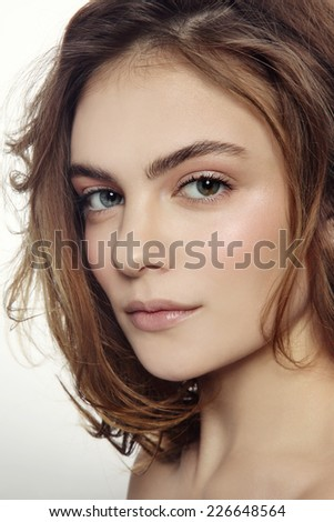 Portrait of young beautiful sexy girl with clean make-up and messy hairdo - stock photo